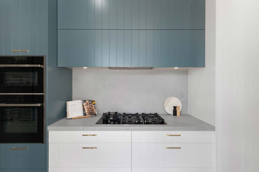 V-groove kitchen design featuring Caesarstone Airy Concrete, kitchen showroom display at Premier Kitchens Drummoyne