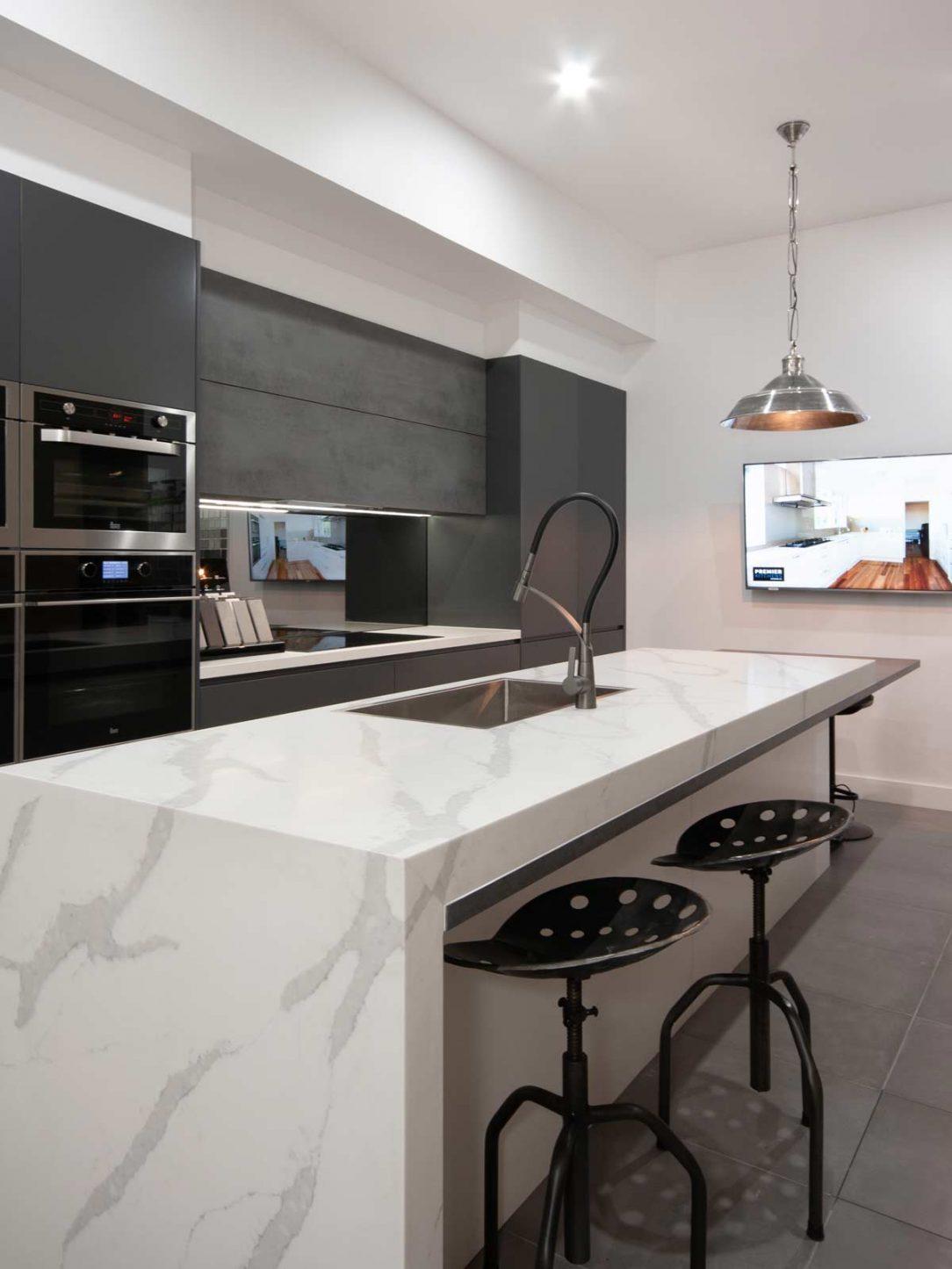 Contemporary kitchen design featuring Smartstone benchtop, on display at Premier Kitchens Drummoyne