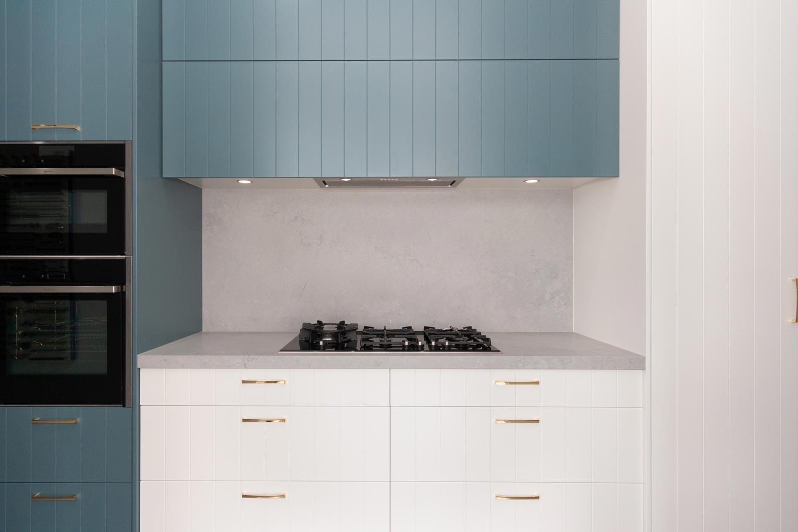 Kitchen design display featuring Caesarstone Airy Concrete benchtop at Premier Kitchen's Showroom, Drummoyne.