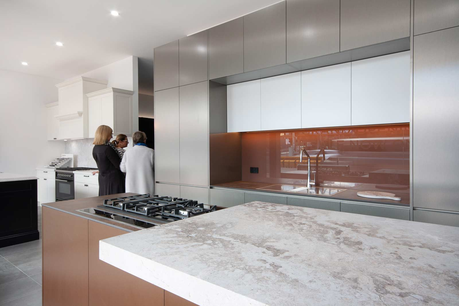 Kitchen design display featuring Caesarstone Excava benchtop at Premier Kitchen's Showroom, Drummoyne.