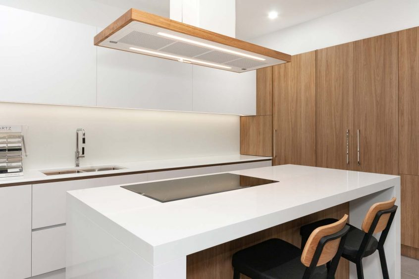 minimalist Scandinavian kitchen design featuring Quantum Quartz Ultra White benchtop. On display at Premier Kitchens Showroom Drummoyne.