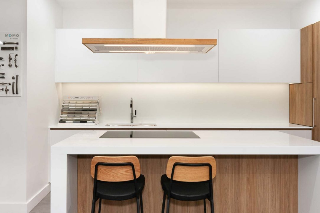 minimalist Scandinavian kitchen design featuring Quantum Quartz Ultra White benchtop. On display at Premier Kitchens Showroom Drummoyne.