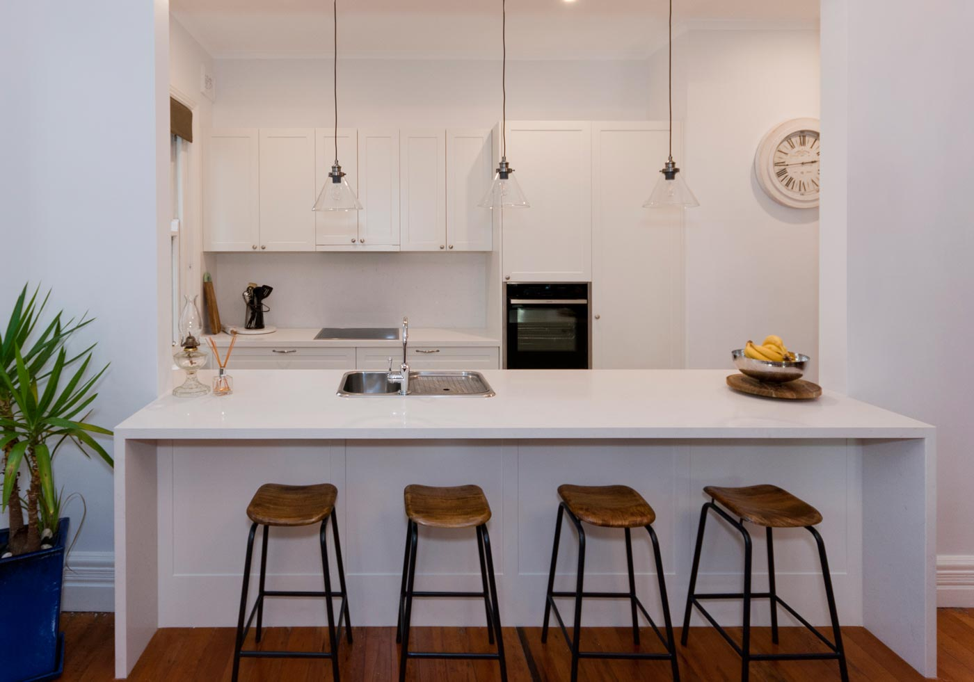 Classic white kitchen design featuring Caesarstone Pure White benthop, Dulux Whisper White poly doors, Neff appliances, Clark sink & Astra Walker tapware. Designed by Premier Kitchens Australia.