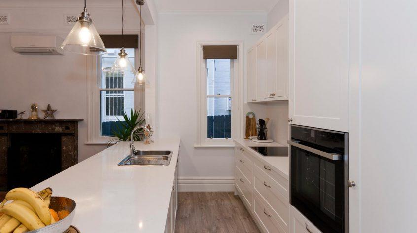 caesarstone-frosty-carina-dulux-polyurethane-whisper-white-classic-kitchen-design-astra-walker-clark-sink-premier-kitchens-australia-5