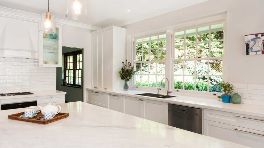caesarstone benchtop miele appliances hamptons kitchen design white polyurethane cabinets blum hardware shaker doors