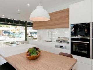 Modern Scandinavian kitchen design featuring Caesarstone Pure White & Neolith La Boheme benchtop, Dulux Whisper White poly and timber veneer doors, Elica & Neff appliances, Clark sink & Abey tapware. Designed by Premier Kitchens Australia.