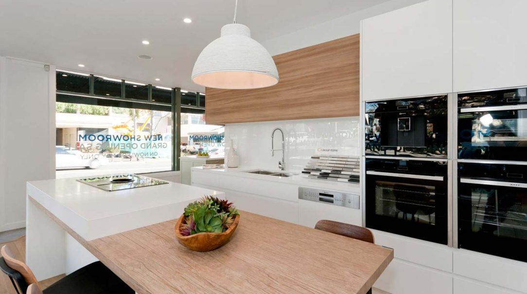 Modern Scandinavian kitchen design featuring Caesarstone Pure White & Neolith La Boheme benchtop, Dulux Whisper White poly and timber veneer doors, Elica & Neff appliances, Clark sink & Abey tapware. Designed by Premier Kitchens Australia.