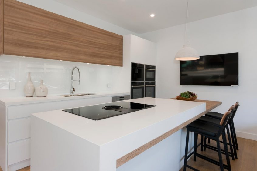 Scandinavian kitchen design featuring Caesarstone Pure White & Neolith La Boheme benchtop, Dulux Whisper White poly and timber veneer doors, Elica & Neff appliances, Clark sink & Abey tapware. Designed by Premier Kitchens Australia.