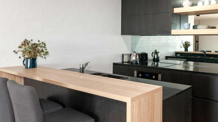 Kitchen design featuring Caesarstone benchtop, polytec cabinets & Omega appliances.