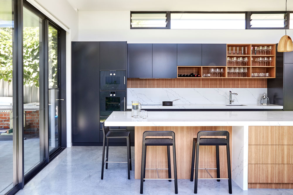 modern kitchen design after kitchen renovation using quantum quartz venatino statuario benchtop, black polyurethane & NAV timber veneer kitchen cabinets