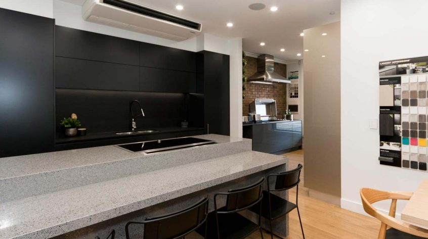 Black kitchen design featuring Dulux Domino polyurethane cabinets, clark sink, Dorf kitchen mixer, Essa Stone and Dekton benchtop.
