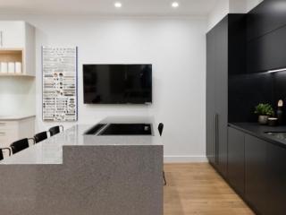Black kitchen design featuring Dulux Domino polyurethane cabinets, clark sink, Dorf kitchen mixer, Essa Stone and Dekton benchtop.