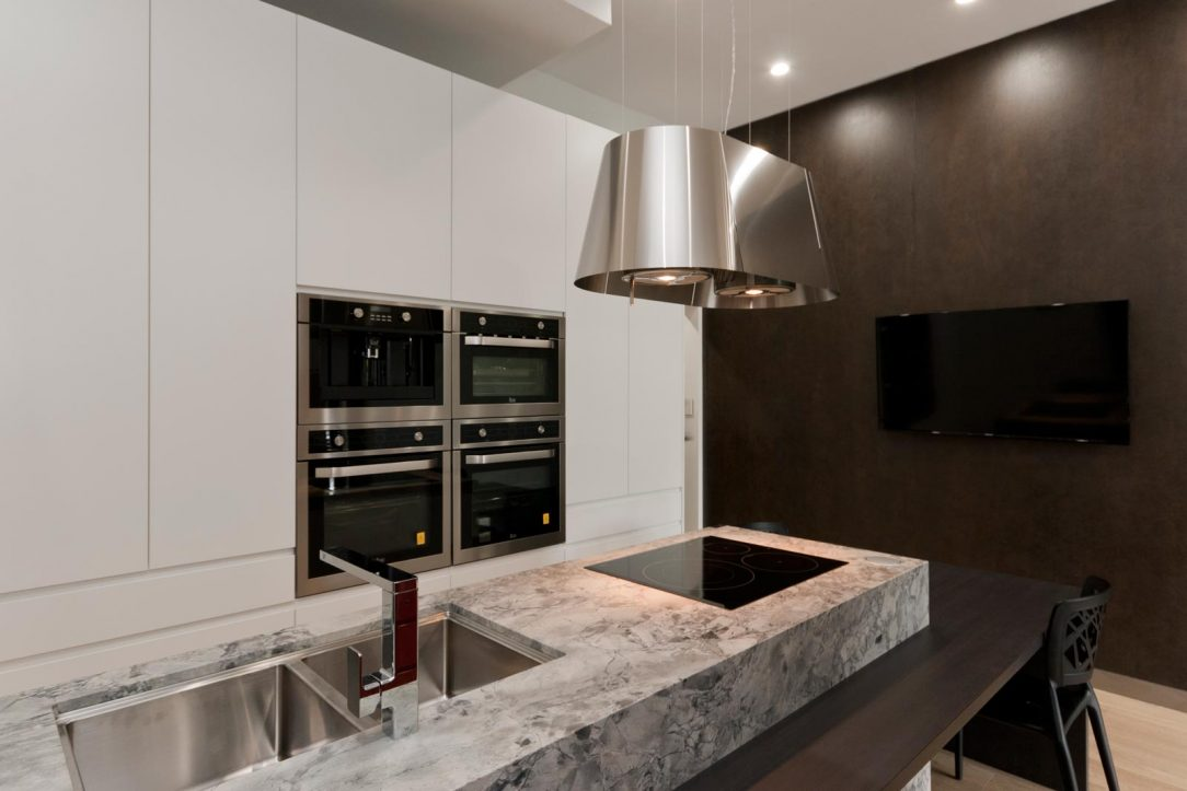 Contemporary kitchen design with Dulux polyurethane kitchen cabinets, Pete Evans tapware, CDK superwhite natural stone benchtop, on display at Premier Kitchens 54 Penshurst St Willoughby
