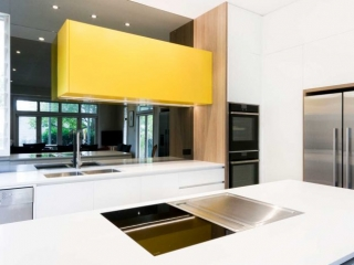 Modern, edgy kitchen design featuring Dulux polyurethane cabinets in white, grey and yellow, Polytec Oak feature panel, Silestone benchtop, Neff & Bora cooking appliances & Clark sink & mixer.