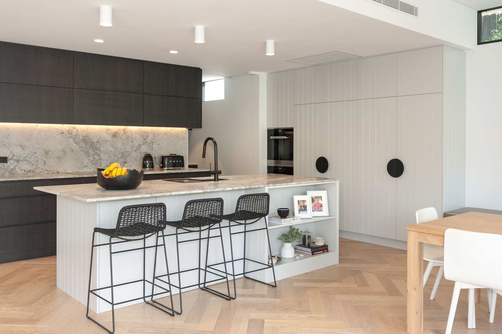 Dulux polyurethane v-groove cabinets, dark grey kitchen design with Polytec feature cabinets, miele and smeg appliances, butlers pantry and custom banquet seating