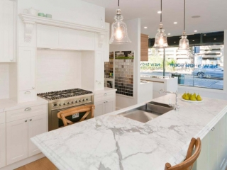 French provincial kitchen design featuring Dulux Whisper White poly shaker doors, Elba Marble benchtop, Ilve stove & Clark sink. Designed by Premier Kitchens Australia.