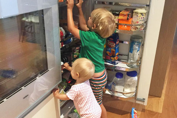 kids-climbing-through-kitchen-cabinets-polyurethane-timber-veneer-integrated-fridge gaggenau appliances