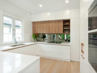 Kitchen design Sydney modern Miele Vintec Dulux polyurethane white cabinets timber grain Premier Kitchens Australia