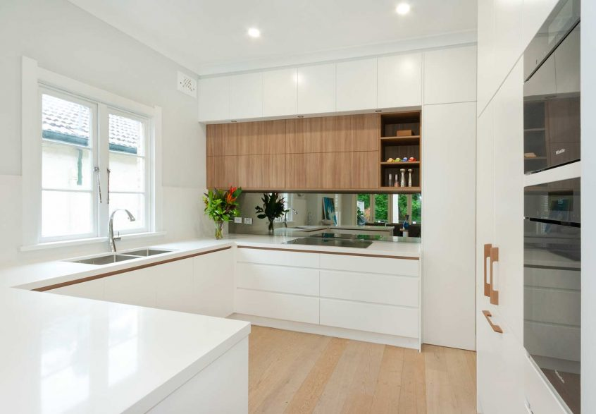 Modern white and timber kitchen design featuring Miele appliances, Vintec wine fridge, Dulux polyurethane white and timber grain cabinets. Kitchen designed by Premier Kitchens Australia.