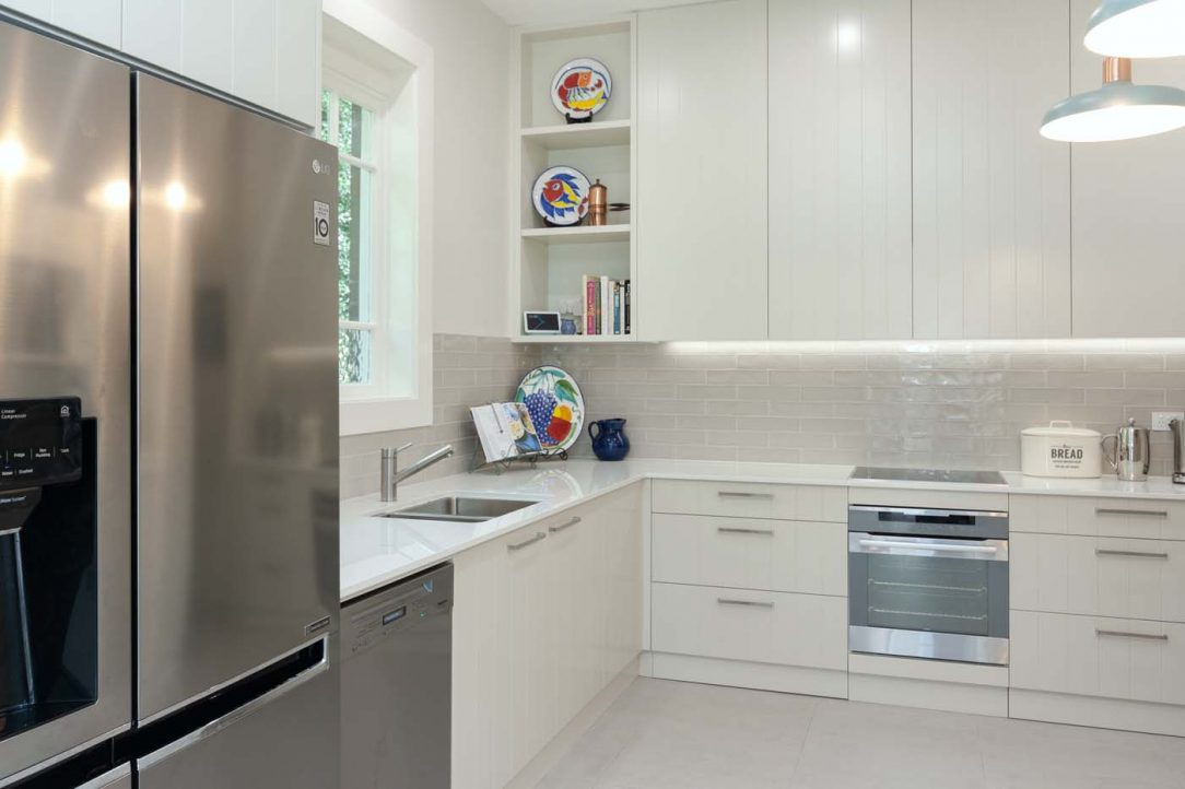 Kitchen design featuring Dulux White Duck polyurethane v-groove cabinets, Miele dishwasher, LG fridge and Dekton Glacier benchtop