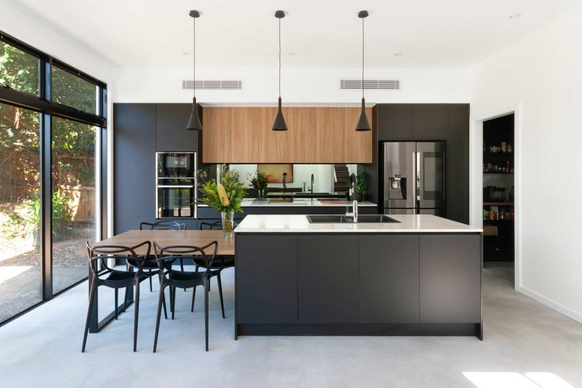 Dark kitchen design featuring Matt Blatt chairs, Samsung fridge, Silestone benchtop, Abey sink, made by Premier Kitchens Australia