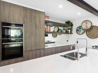 Rustic kitchen design featuring Miele dishwasher, Quantum Quartz benchtop, Bora cooktop, Neff oven & Polytec timber grain cabinets
