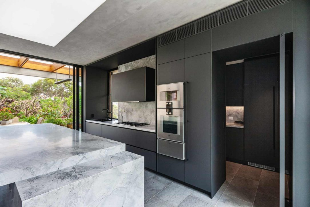 Kitchen design featuring natural superwhite stone benchtop, Liebherr fridge freezer, Zip tap and Gaggenau appliances.