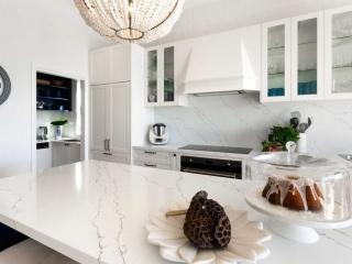 Hamptons beach style kitchen design featuring Fisher & Paykel integrated fridge freezer, Dulux polyurethane white & blue cabinets, Quantum Quartz benchtop, Smeg & Miele appliances.