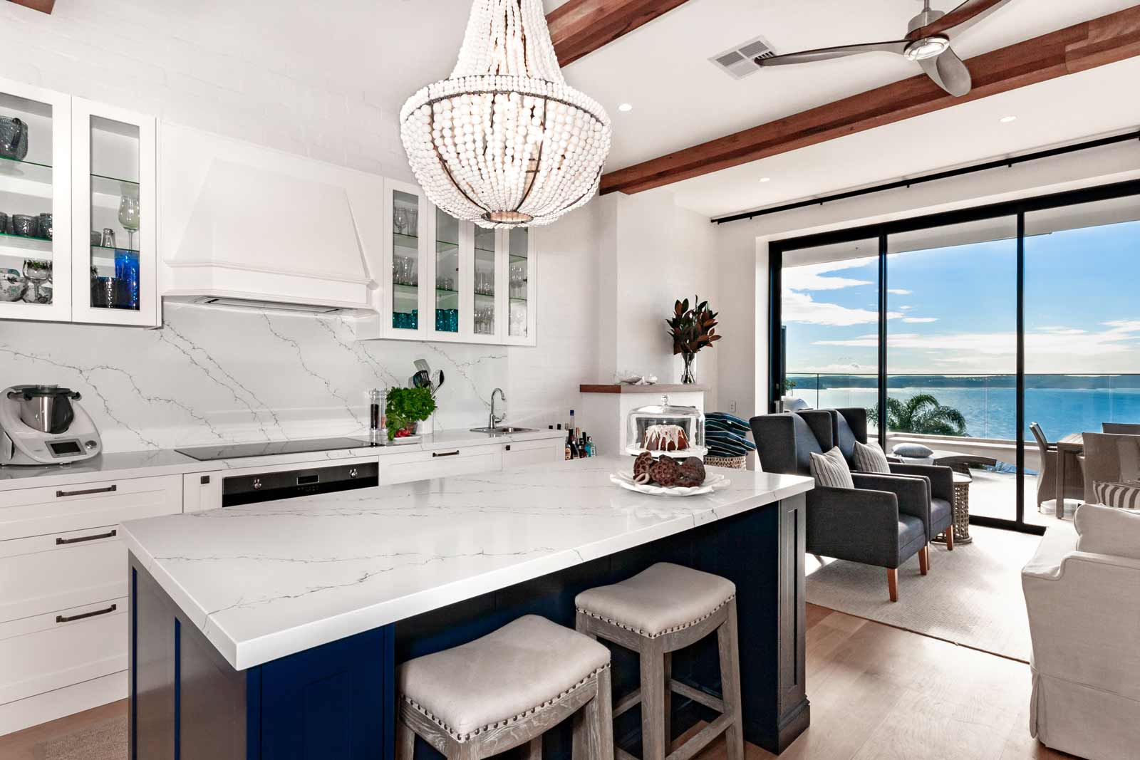 Hamptons style beachside kitchen design featuring Fisher & Paykel fridge/freezer, dulux polyurethane shaker cabinets, Quantum Quartz benchtop, Miele & Smeg appliances.