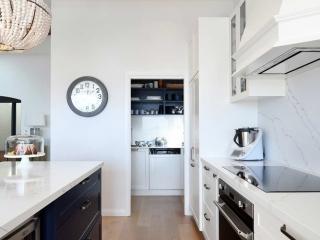 Hamptons style beachside kitchen design featuring Fisher & Paykel fridge/freezer, dulux polyurethane shaker cabinets, Quantum Quartz benchtop, Miele & Smeg appliances.