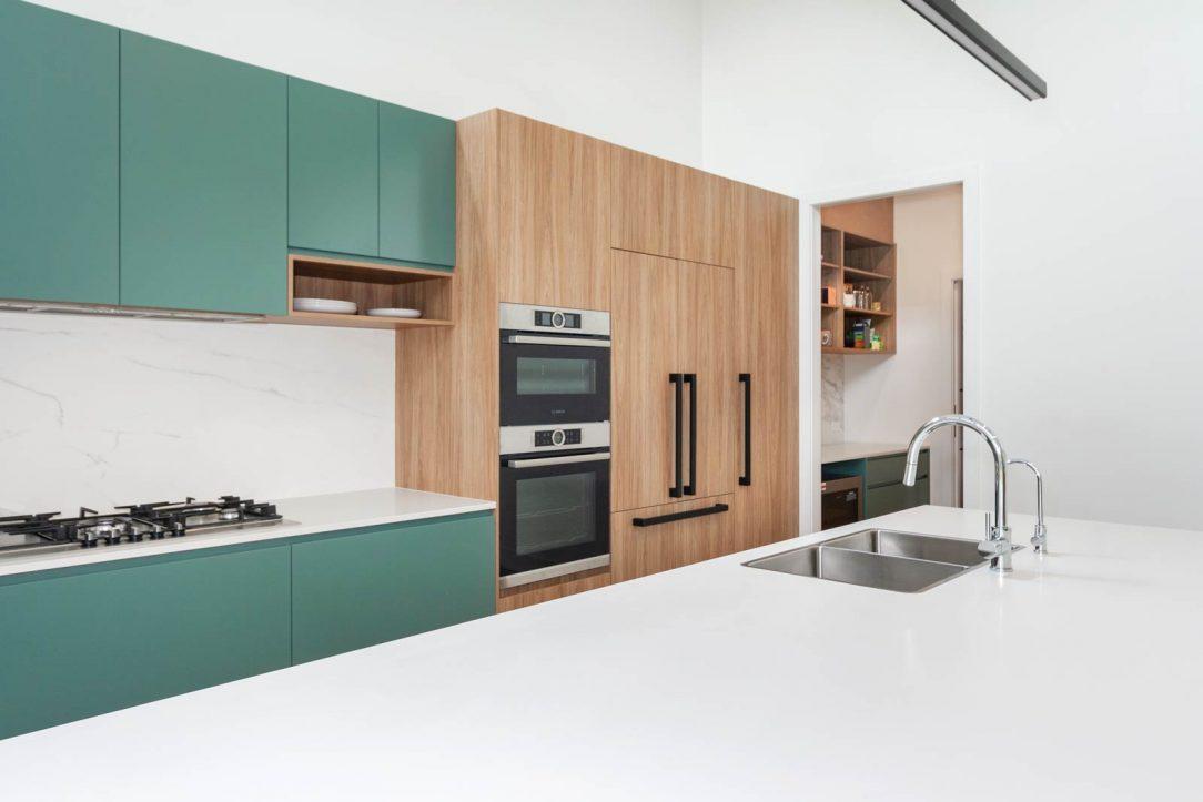Modern kitchen design Sydney, Bosch, Fisher & Paykel, green & timber cabinets designed by Premier Kitchens Australia