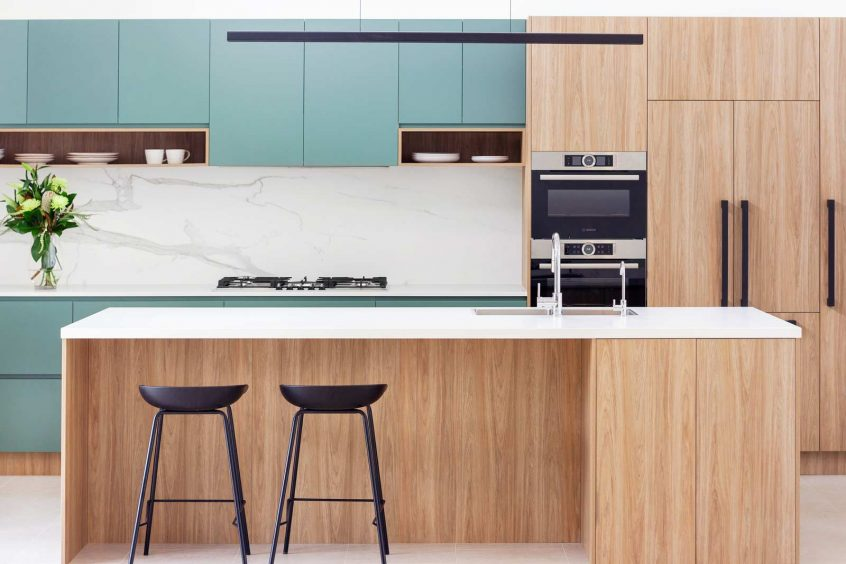 Modern green, white and timber kitchen design featuring Bosch, Fisher & Paykel. Kitchen designed by Premier Kitchens Australia