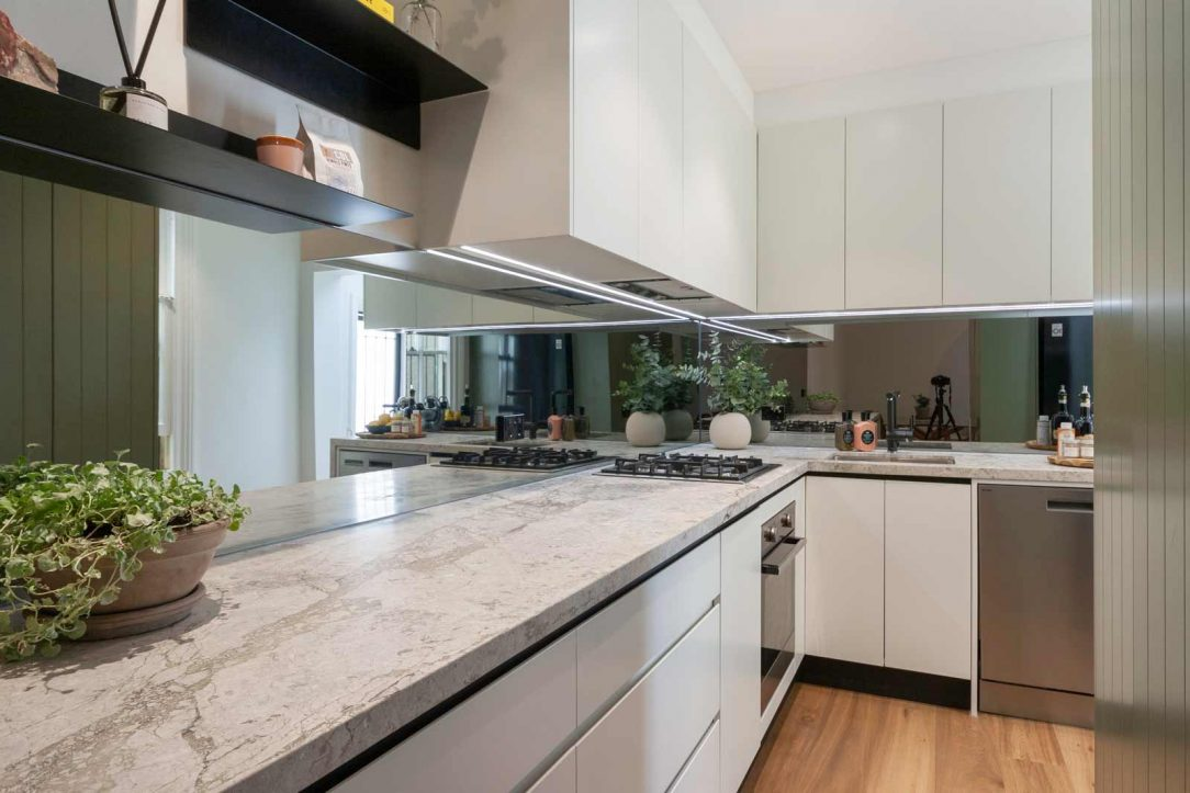 Kitchen design Sydney modern Dulux Jungle Cloak polyurethane v-groove cabinets natural limestone benchtop by Premier Kitchens Australia