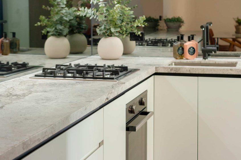 Kitchen design Sydney modern Dulux Jungle Cloak polyurethane v-groove cabinets natural limestone benchtop by Premier Kitchens Australia