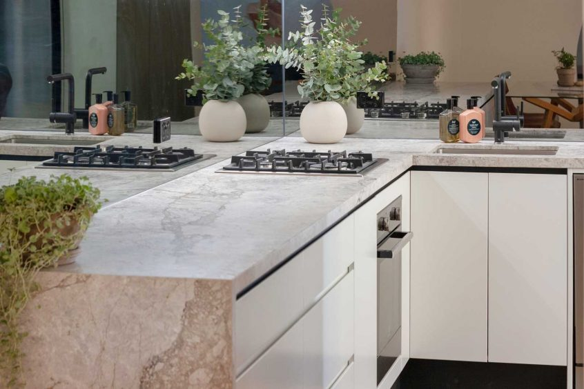 Modern Sydney kitchen design featuring two-tone Dulux polyurethane cabinets and gorgeous natural limestone benchtop. Kitchen designed by Premier Kitchens Australia