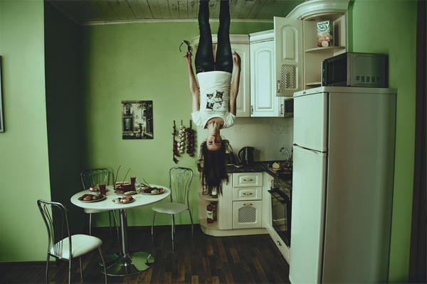kitchen in rental property tenant standing upside down on ceiling