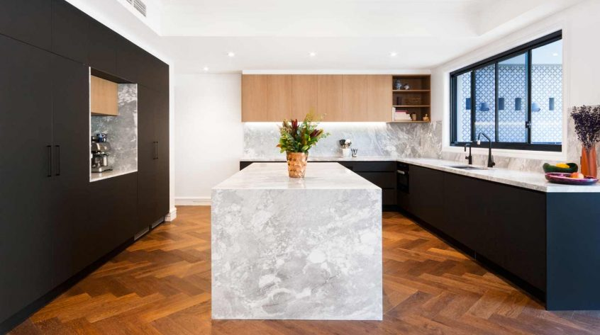 Black kitchen design featuring Miele appliances, Blum cabinet hardware, Sirius rangehood, Liebherr fridge, Franke sink and natural superwhite dolomite stone benchtop.