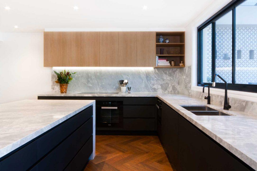 Black kitchen design featuring Miele appliances, Blum cabinet hardware, Sirius rangehood, Liebherr fridge, Franke sink and natural superwhite dolomite stone benchtop.