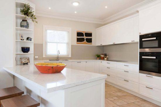 Hamptons style kitchen design featuring Miele appliances, Dulux polyurethane shaker doors in Whisper White & Silestone quartz bench top in Blanco Orion.