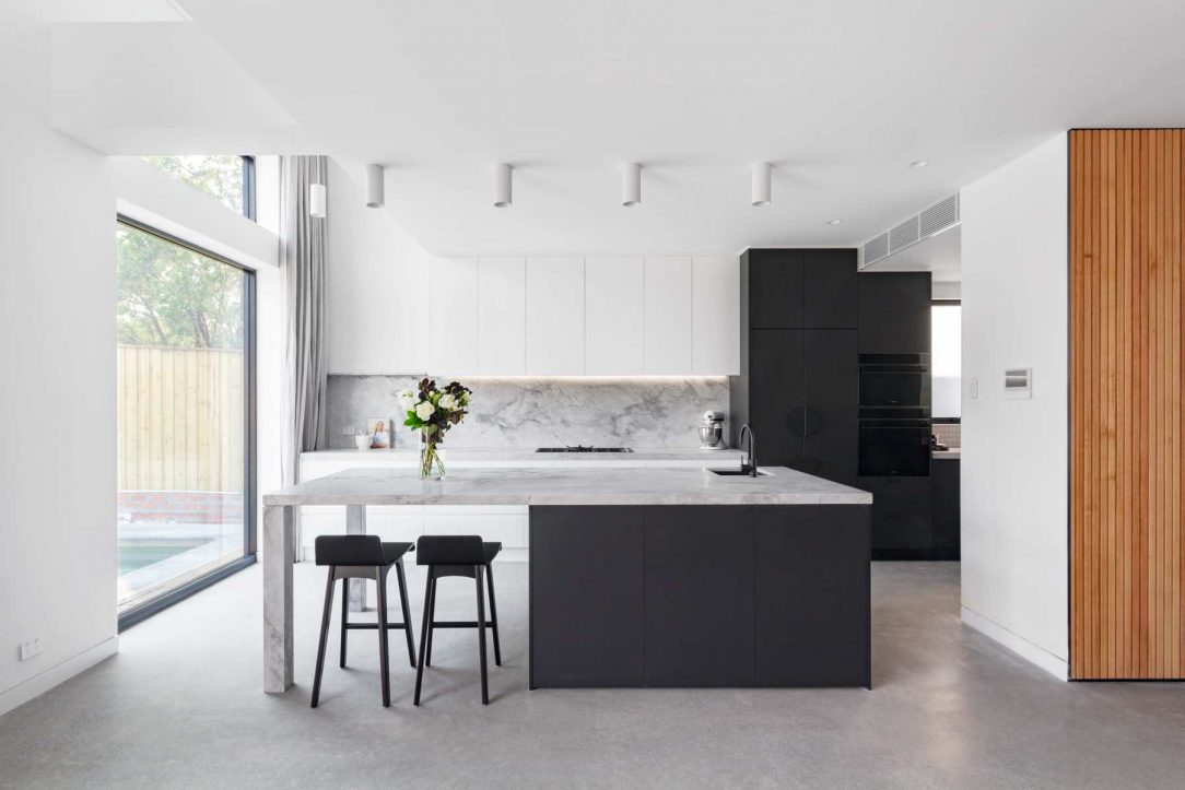 modern contemporary kitchen design smeg appliances, black white cabinetry, superwhite grey stone benchtop splashback v-groove cabinets