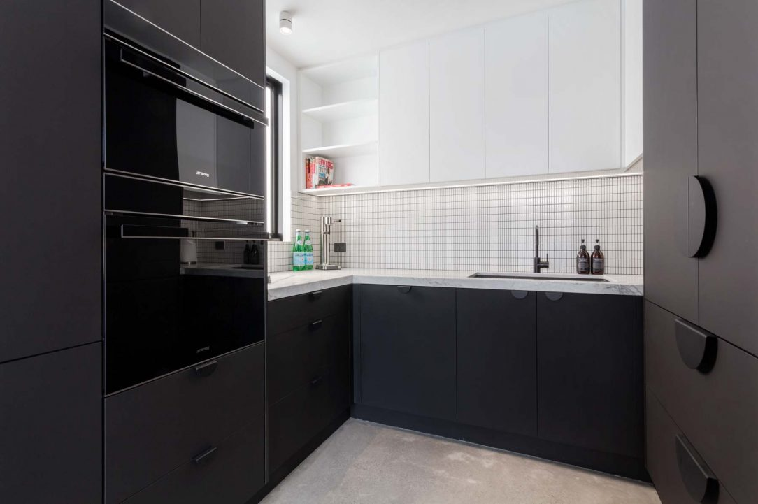 modern contemporary kitchen design butlers pantry smeg appliances, black cabinetry, superwhite stone benchtop