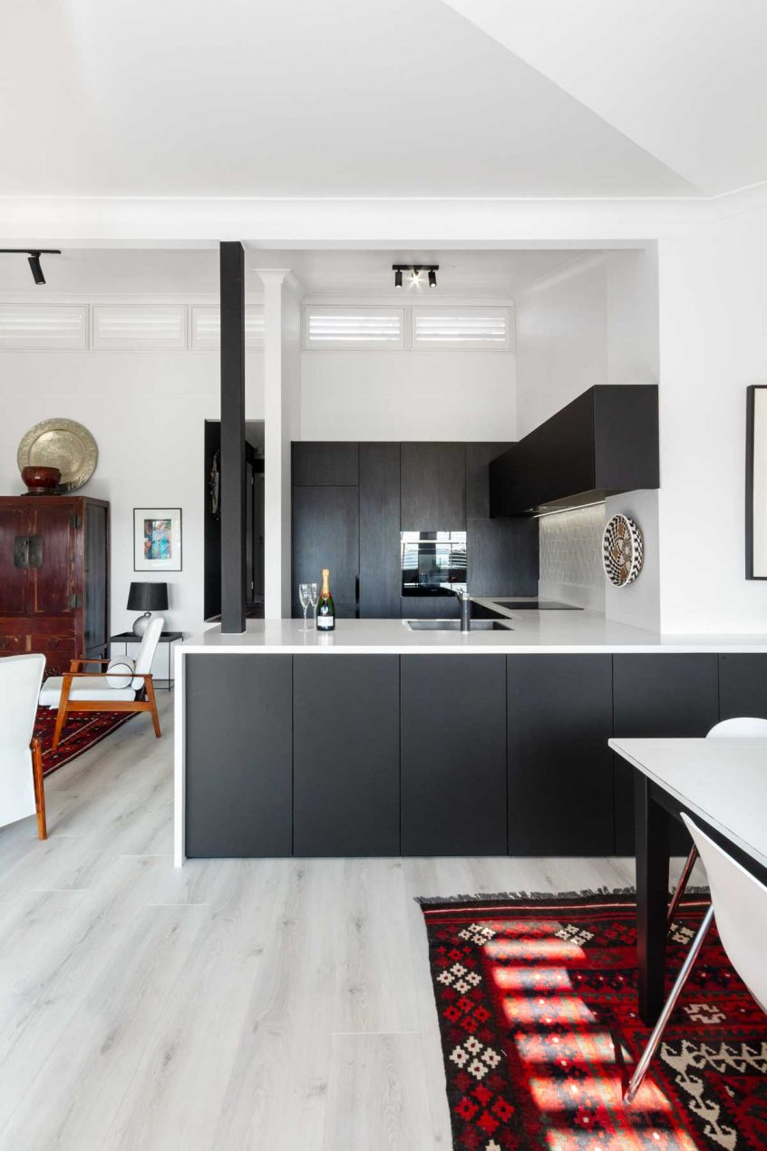 modern black and white kitchen design by Premier Kitchens Australia. Featuring bosch integrated dishwasher, smeg oven and rangehood, teka cooktop, blanco sink and mixer, polytec black wenge and traceless matt black cabinets and corian salt benchtop.