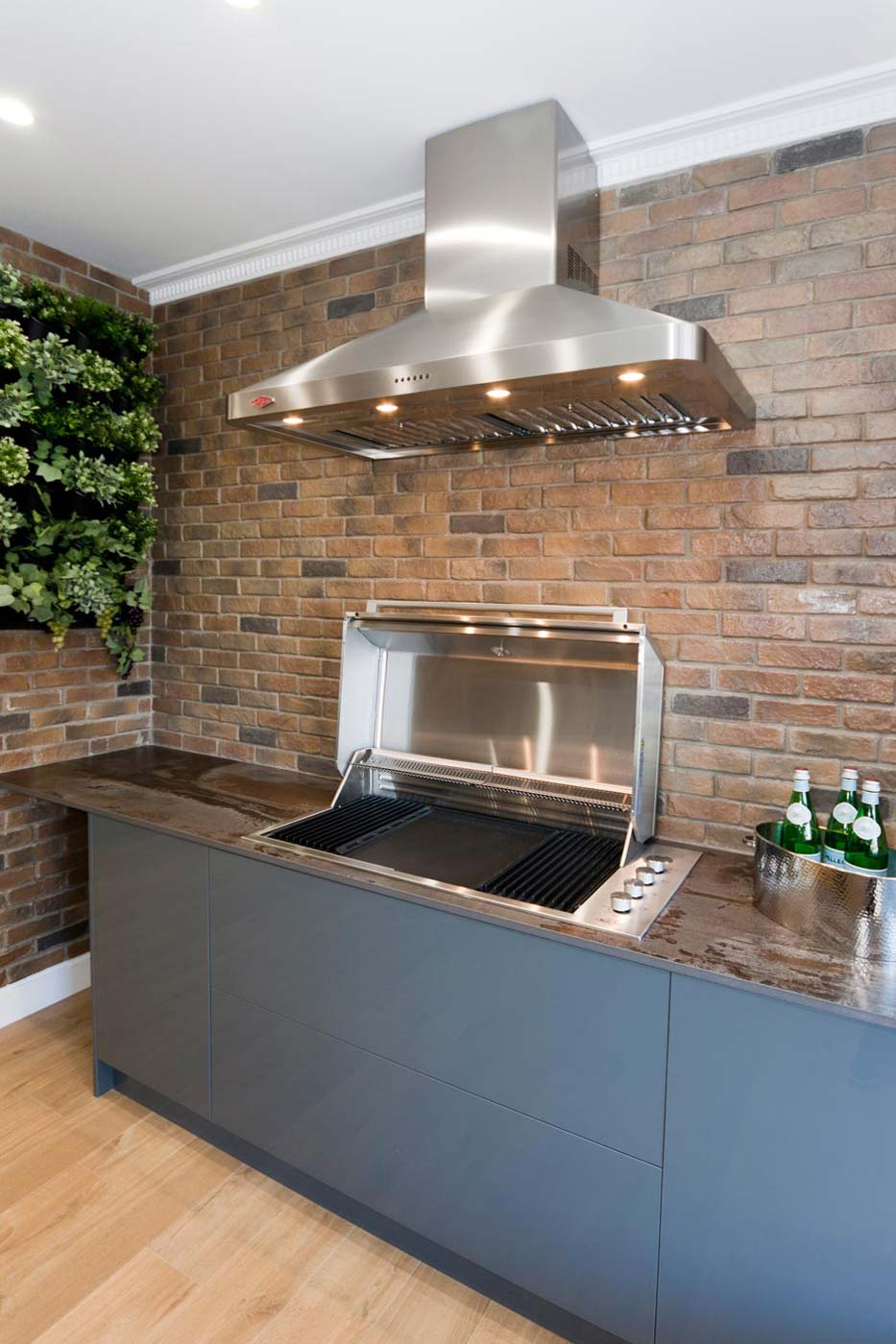 Outdoor kitchen design BBQ with Neolith benchtop and canopy rangehood. On display at Premier Kitchens Showroom, 63 Penshurst St, Willoughby.