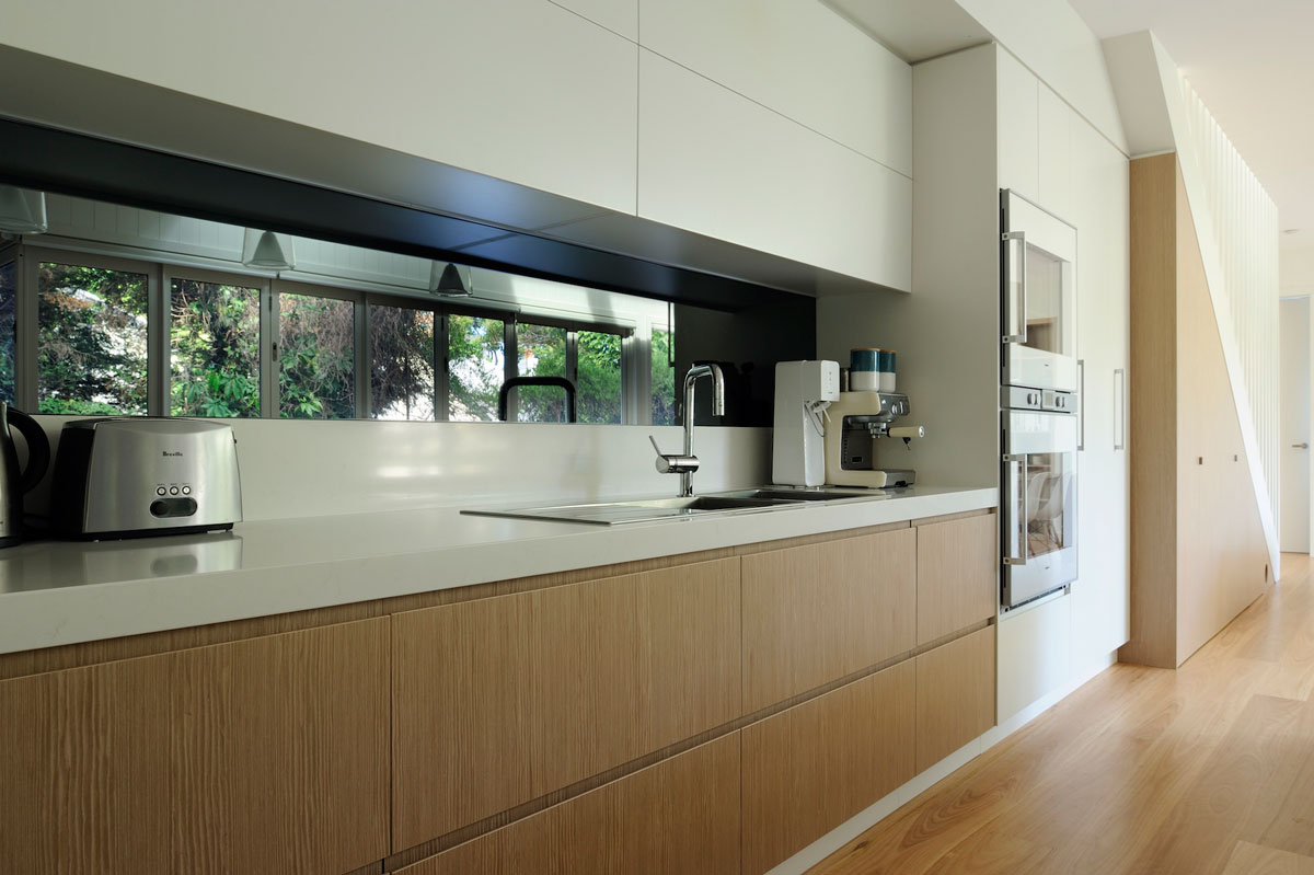 modern kitchen design with quantum quartz benchtop splashback with tinted mirror