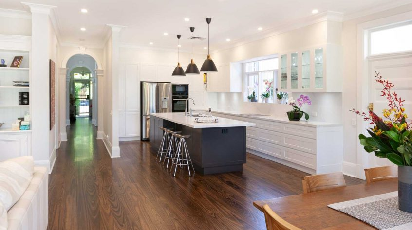 Classic black and white kitchen design featuring dulux shaker kitchen cabinets, Neff oven and Bora cooktop with downdraft